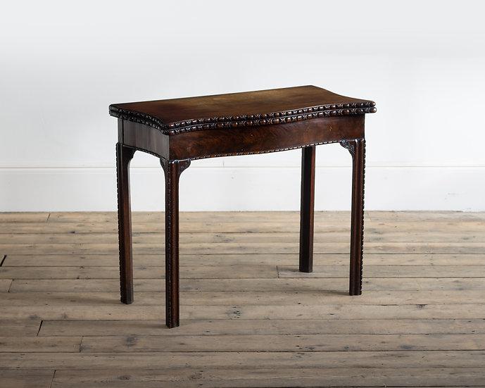 A George III serpentine mahogany card table