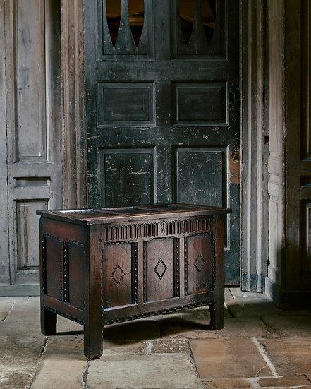 A Charles II oak panelled coffer