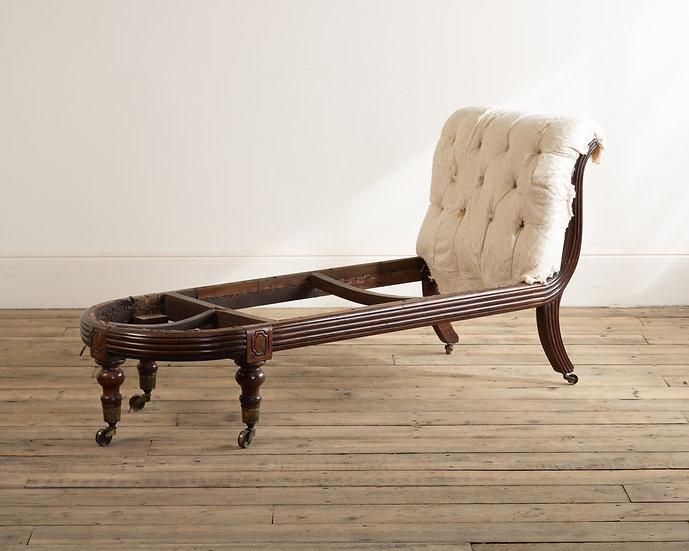 A late Regency mahogany day bed