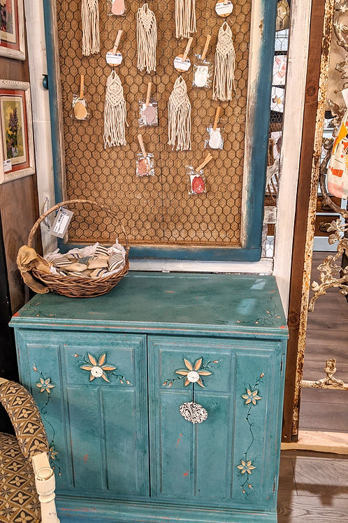 Teal w/chippy red underneath cabinet/side table
