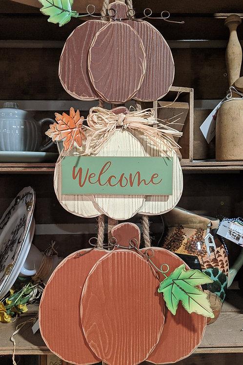 Hanging pumpkin welcome sign