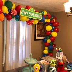 seasame street balloon arch birthday