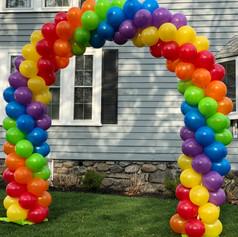 rainbow birthday balloon arch