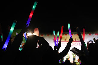 people hands up with Glow stick at party