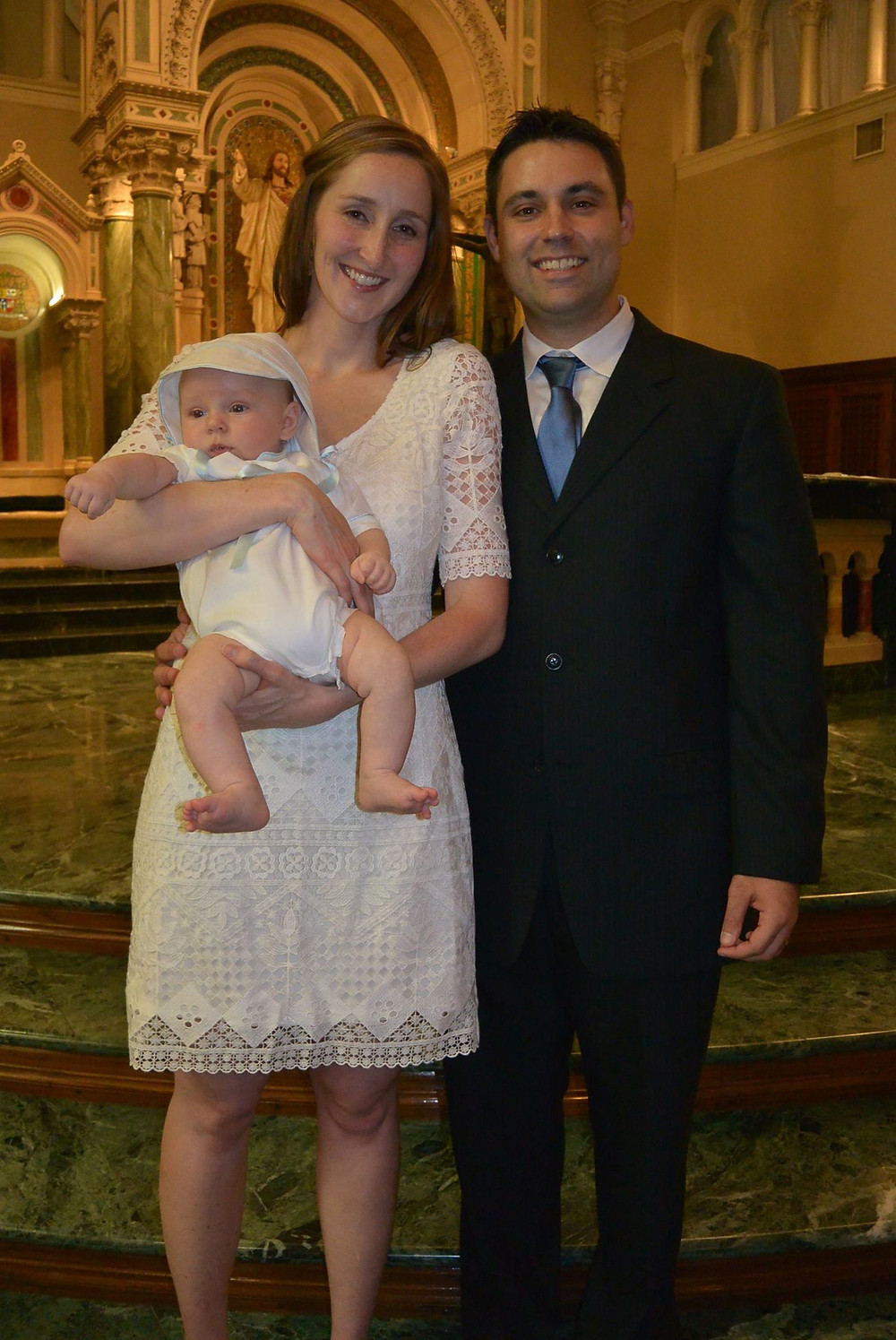 Diana with her husband celebrating their son's baptism.