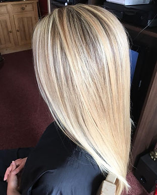 Full head of highlights witha cur and blow dry