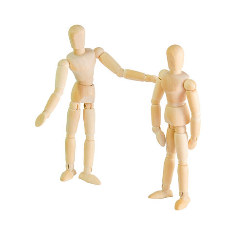 two wooden dolls figure joyfully talking