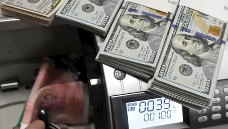 Dollar Muted as Safe-Haven Demand Fades on Stimulus Hopes