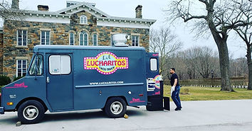 "Grey food truck with a colorful ""Lucharitos"" decal"