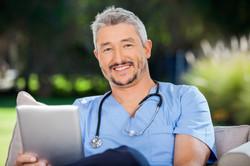 bigstock-Portrait-of-smiling-male-docto-83262461