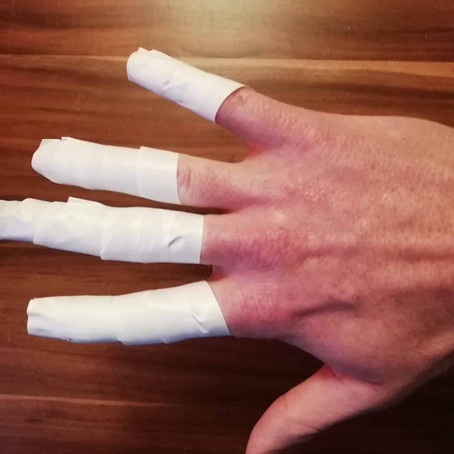 Why Do Volleyball Players Wear Finger Tape? [& How-To-Tape with Pictures]