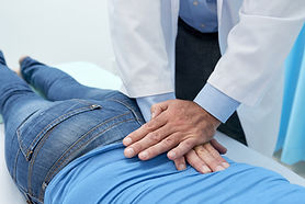cropped-osteopath-adjusting-back-patient-with-massage (1).jpg