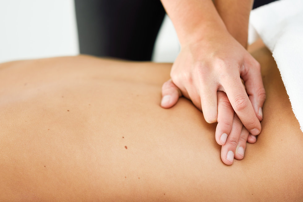 young-female-receiving-relaxing-back-massage-spa-center (1).jpg