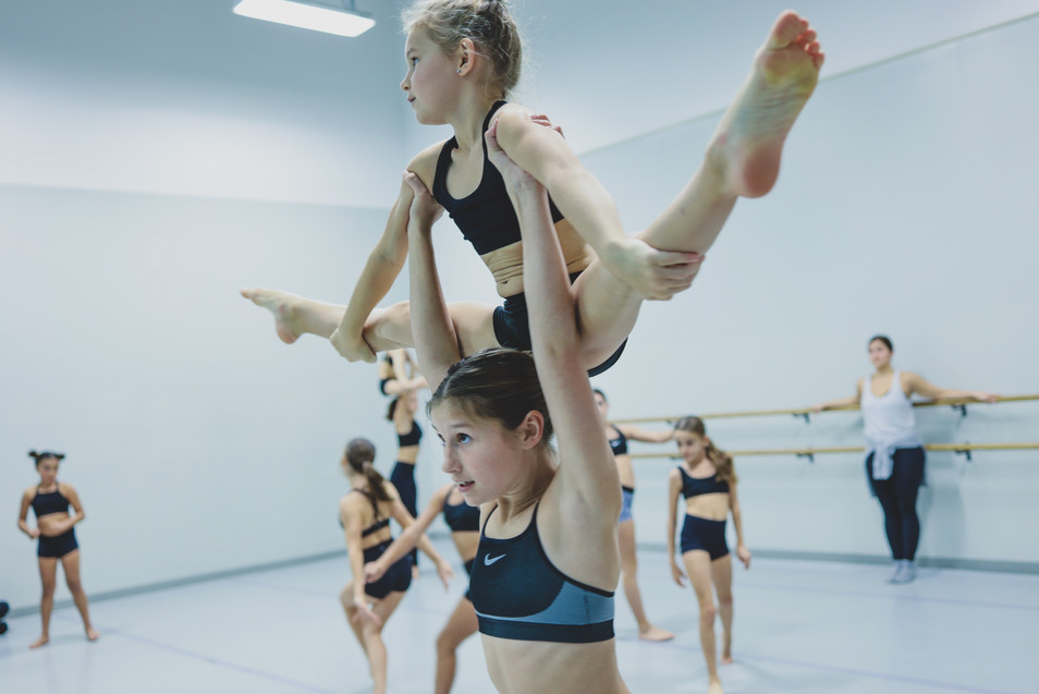 Sisters Ava and Lainey rehearsing acro production.