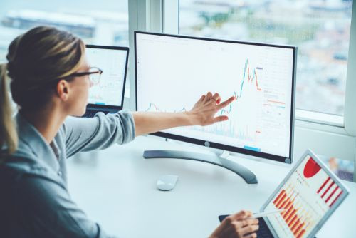 woman reviewing stock graph
