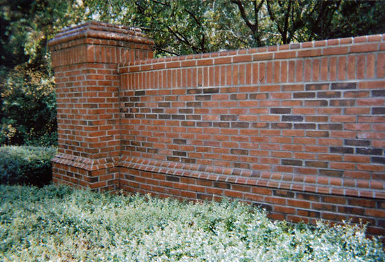 Pressure washed brick fence.