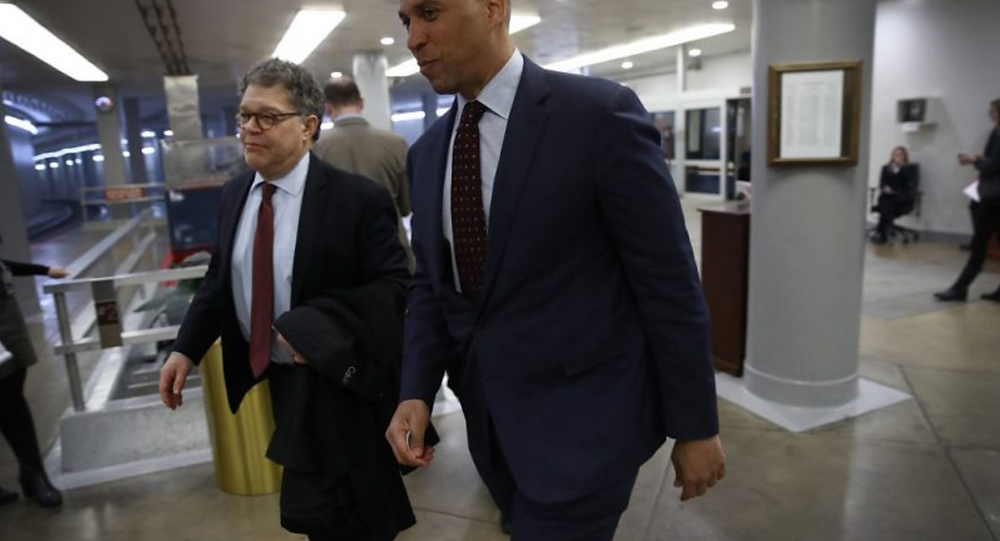 L-R: Sens. Al Franken (D-Minn.) and Corey Booker (D-N.J.) arrive at the U.S. Capitol on February 27, 2017 in Washington, DC. The two senators are among a group of lawmakers who have reintroduced legislation to provide access and protection to medical marijuana patients. (Win McNamee, Getty Images)