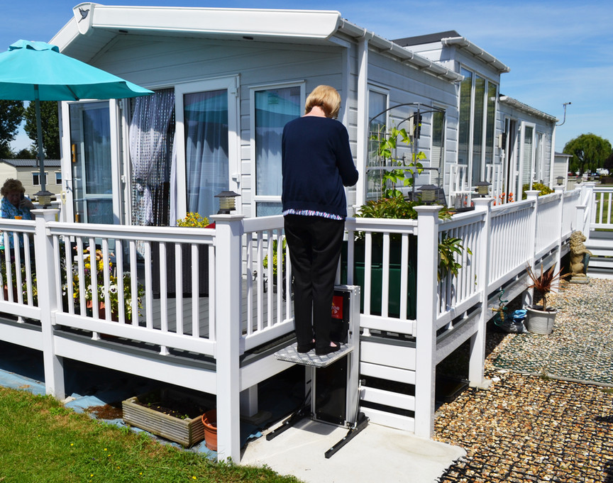 Static caravan steps for a disabled person.