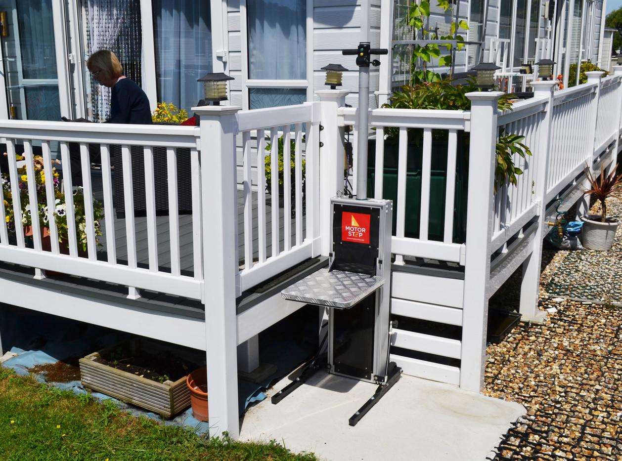 Motorstep static caravan lift with handrail for steps.