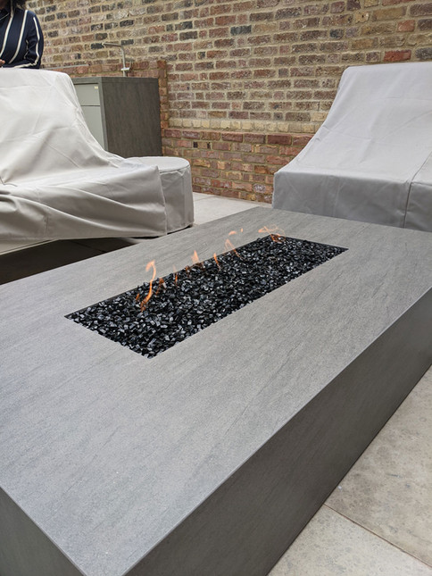 Add a matching firepit to your outdoor kitchen