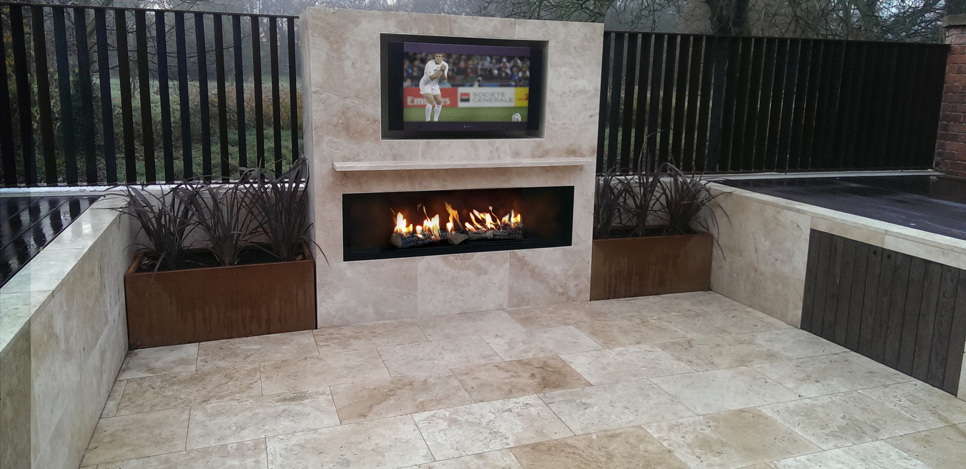 Outdoor gas fireplace 1800mm wide with TV over.