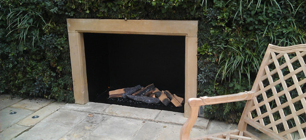 Philimore Gardens green wall outdoor gas fireplace