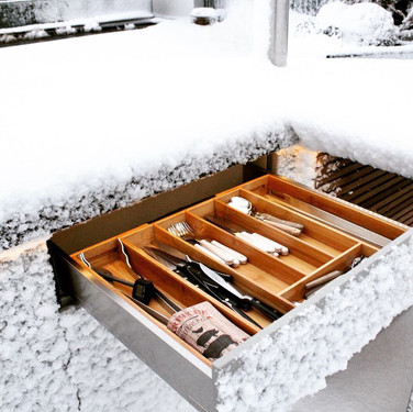 Yes, real snow! But our designs keep your untensils dry for the winter.