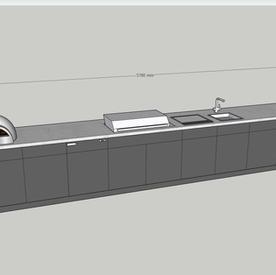 Six metre kitchen (front) with breakfast bar, wine cooler, fridge, teppanyaki, gas grill, fridge and pizza oven  - allow around £32k.