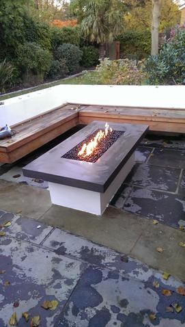 Engineered stone tabletop and masonry base.