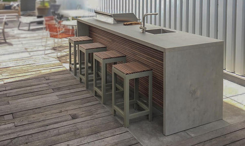 Cubic breakfast bar with matching stools.