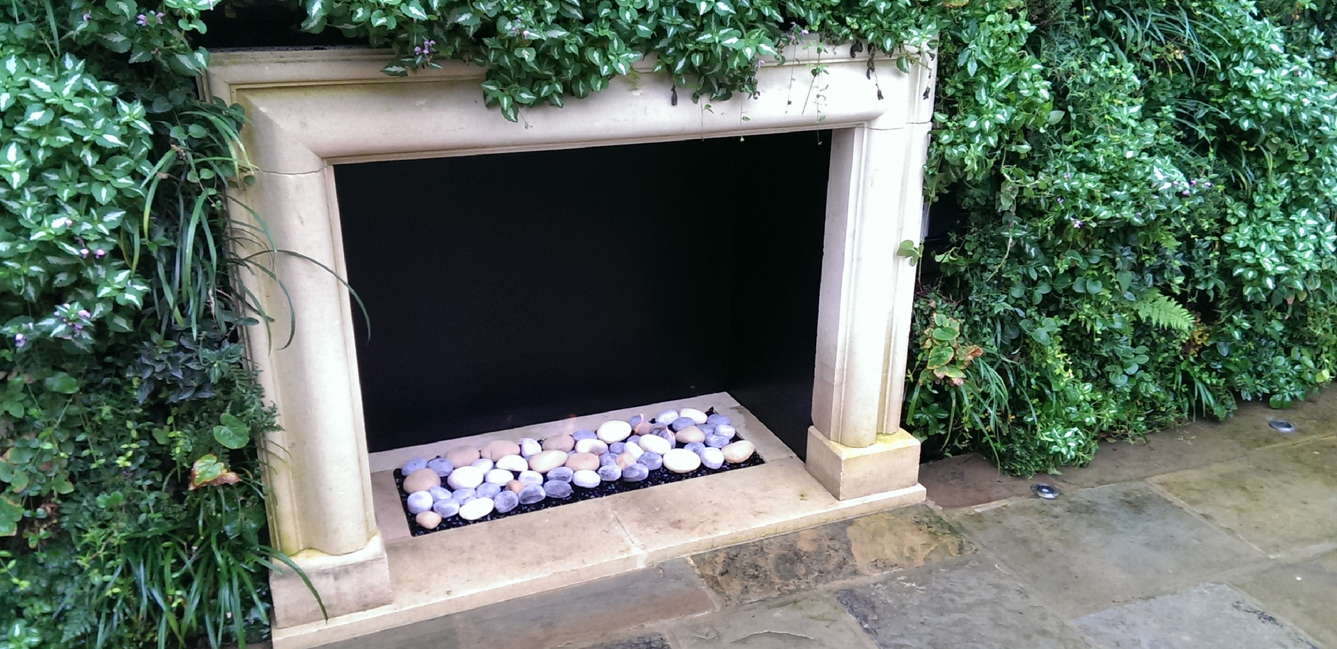 Traditional gas fireplace with ceramic pebbles