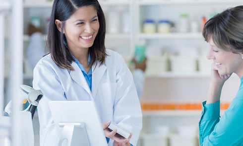 Pharmacist consulting with customer