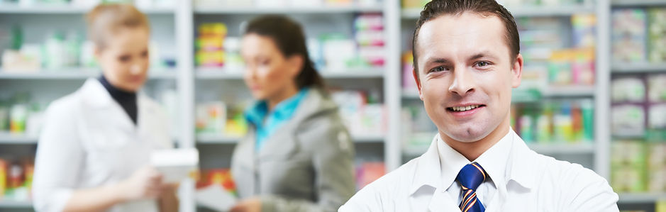 Pharmacists helping patient in a pharmacy