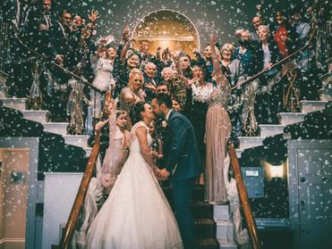 Rudding Park Wedding Photographer | Emma & Matthew's Wedding confetti toss on the grand staircase