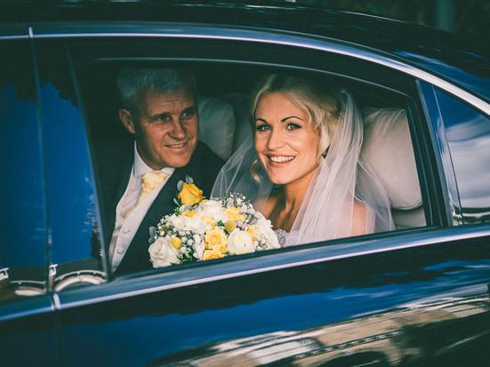 Summer Tickton Grange Wedding Photo bride with father of the bride in wedding car