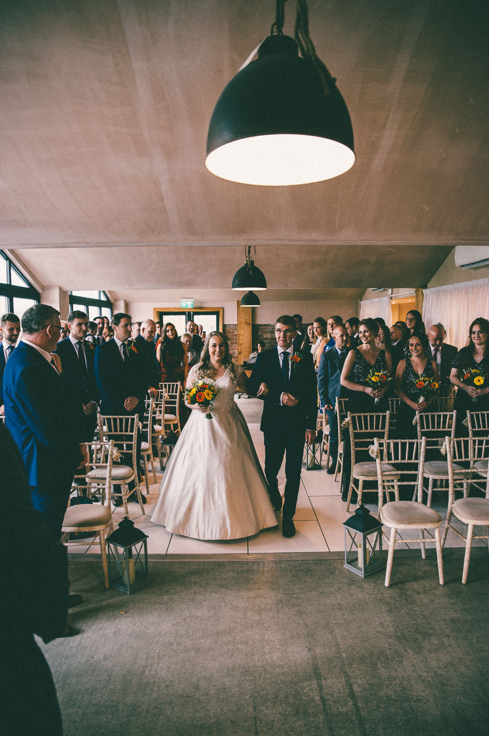 Rustic barn at willerby wedding bride walking down the aisle