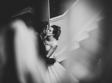 bride and groom on main staircase rudding park wedding photographer