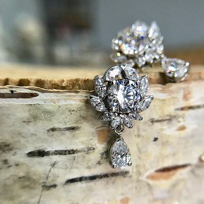 Mixed shape custom platinum and moissanite cluster earrings with pear shaped drop