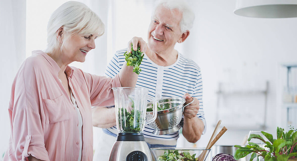 older couple making a smoothie