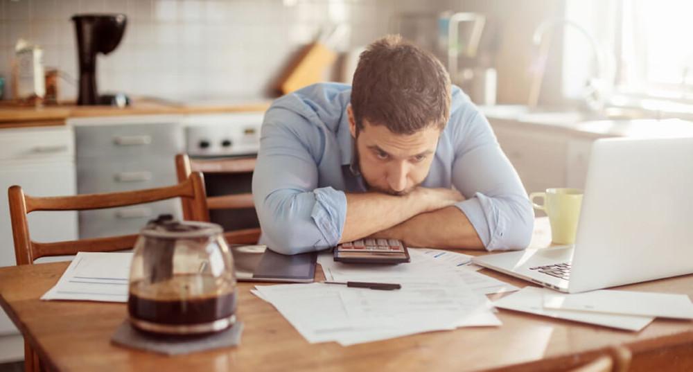 Photo of a man going through his financials problems
