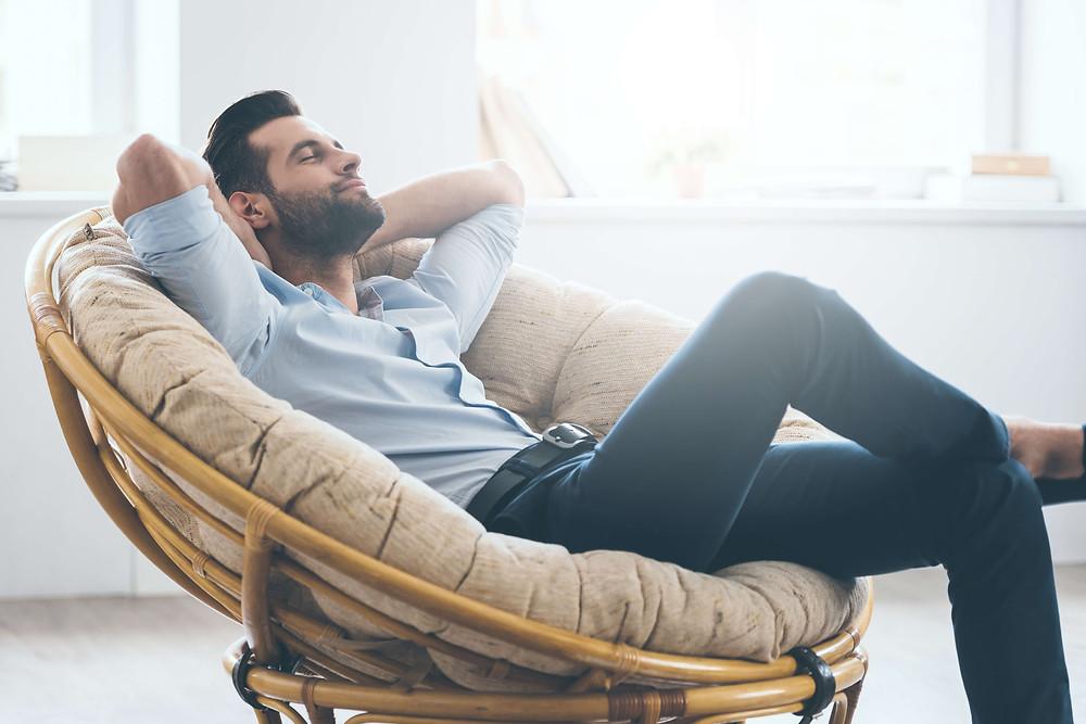 man relaxing in cushy chair