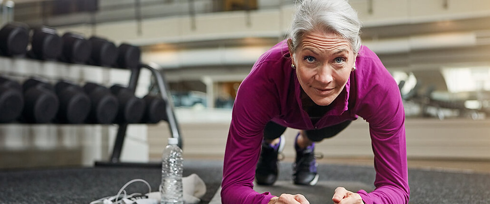 Older woman working out to help prevent and relieve migraines