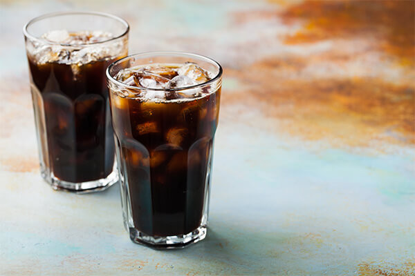 two glasses of cola