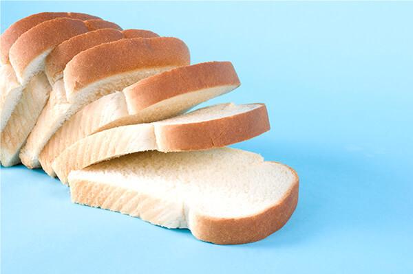 white bread loaf on blue background