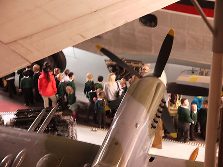 Schoolchildren studying Spitfires and flying boats