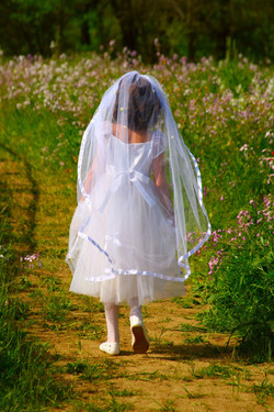 first-holy-communion girl with veil