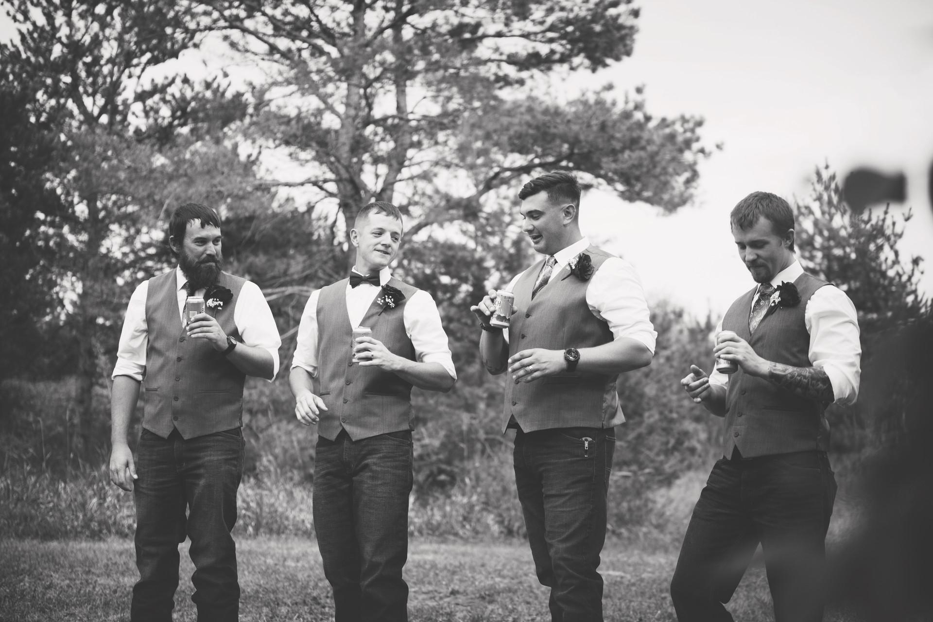 Groomsmen having a beer after ceremony