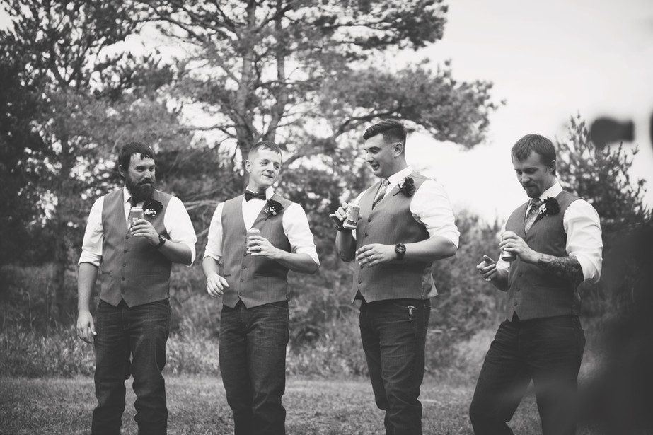 Groomsmen having a beer after ceremony