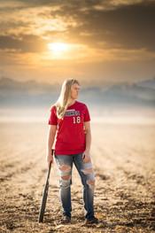 senior softball player in field