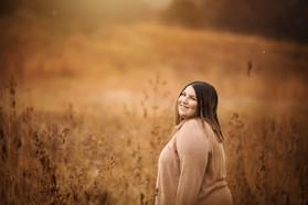 senior girl in a harvest field.